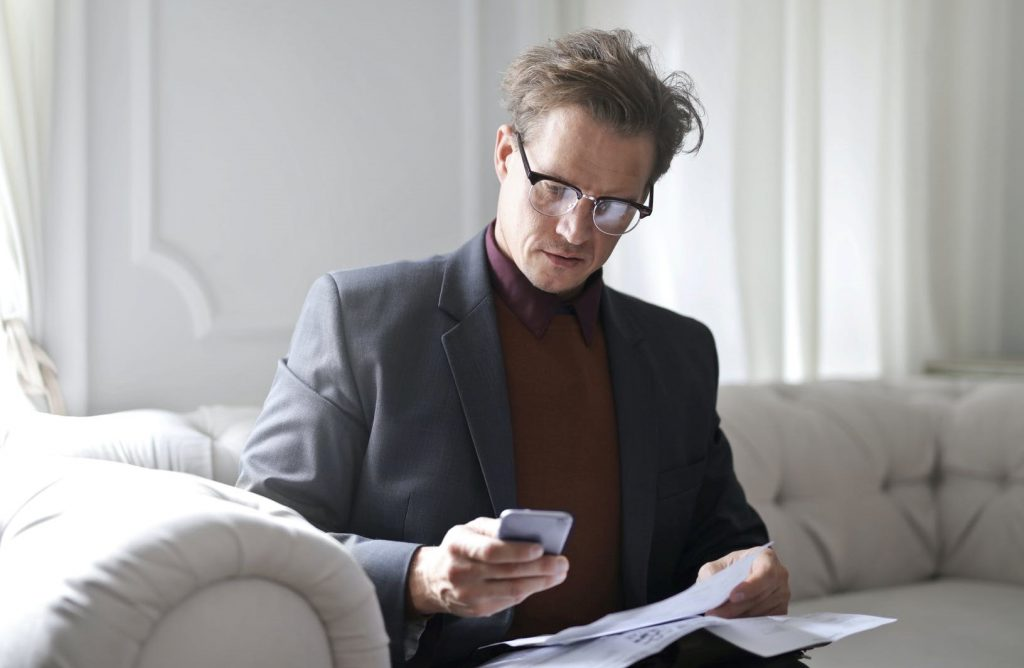 Business man reading about accountability